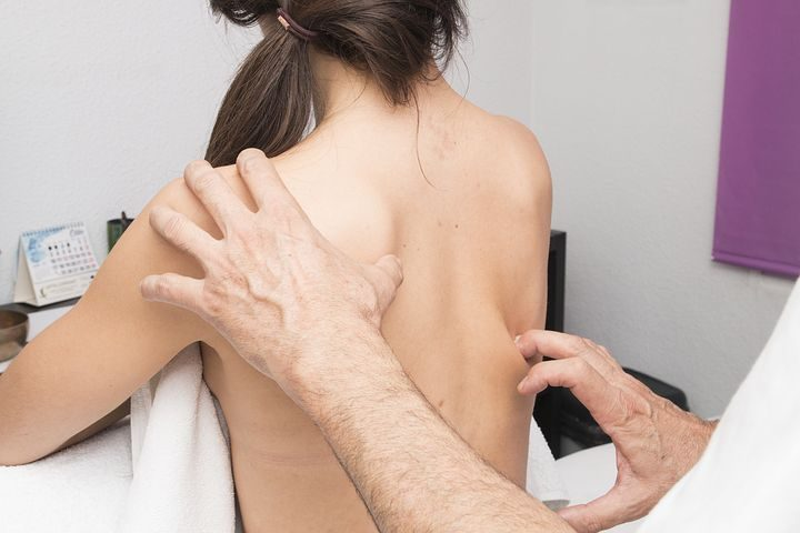 woman getting a spine adjustment